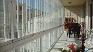 بالکن شیشه ای تاشو-شیشه بالکن ریلی